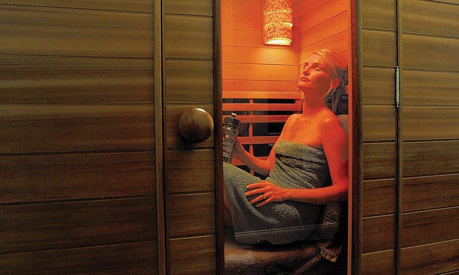 Woman sitting in an infrared sauna.